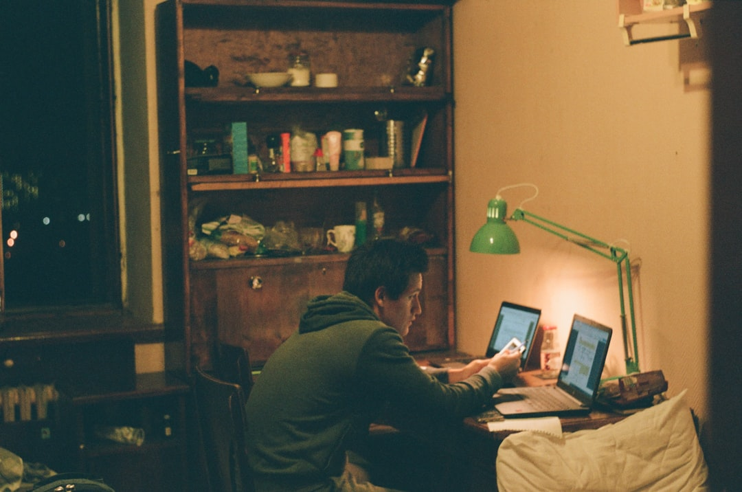 A man sitting in front of a computer